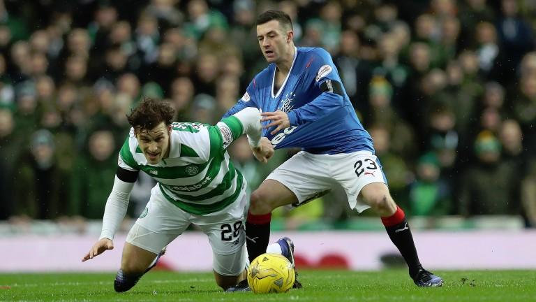 Rangers' Jason Holt battles for the ball against Celtic