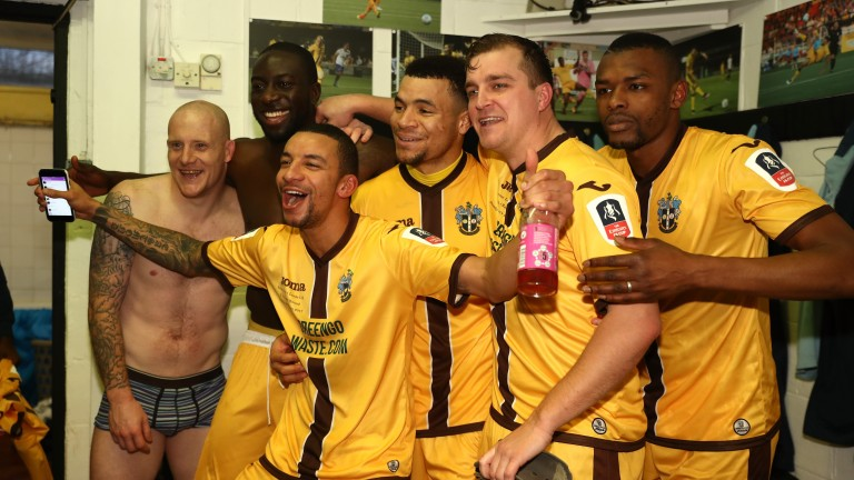 Sutton United's players celebrate their win over Leeds