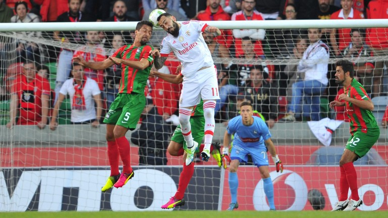 Maritimo defender Dirceu (left) challenges Benfica's Konstantinos Mitroglou for a header