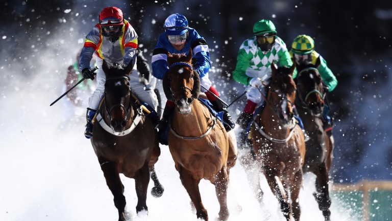 ST MORITZ, SWITZERLAND - FEBRUARY 19:  (L-R) Fox Kieren rides Bytshan along side Pietsch Alexander riding Zyrjann in the Preis Guardaval Immobilien - Zuoz und der Koller Elektro flat race during the White Turf Horse Racing on February 19, 2017 in St Morit