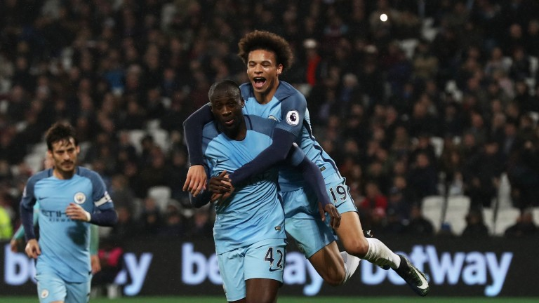 Manchester City's Leroy Sane (19) celebrates with Yaya Toure