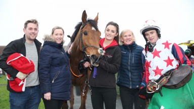 Denise Foster (second right) and Mark Enright celebrate with the team following victory by Miles To Memphis