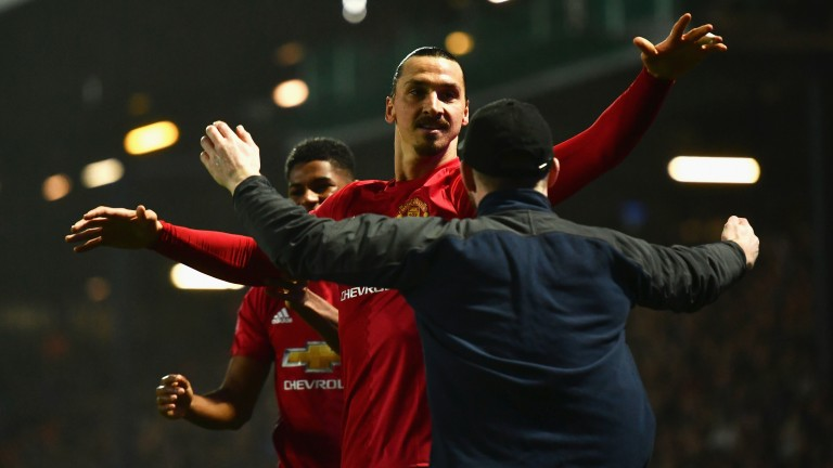 Zlatan Ibrahimovic of Manchester United celebrates with a fan against Blackburn