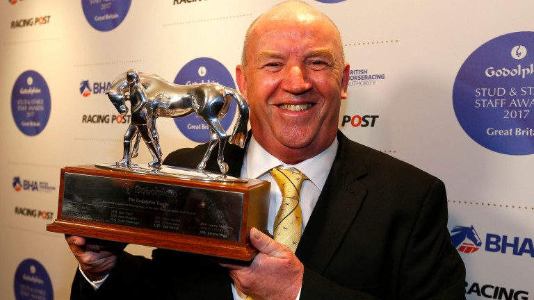 Terry Doherty with his employee of the year trophy