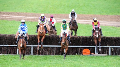 TINAHELY PTP 19-2-2017.RAPID ESCAPE and Jamie Codd (2nd left) clear the 1st fence on their way to win for trainer Gordon Elliott.Photo HEALY RACING.