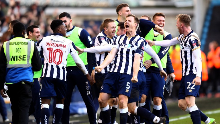 Millwall celebrate reaching the FA Cup quarter-finals