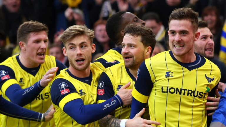 Oxford celebrate during the FA Cup game against Middlesbrough
