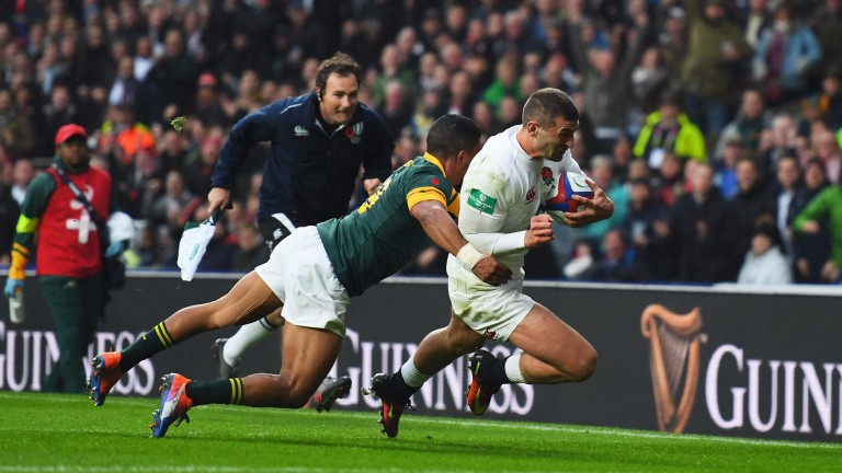 England winger Jonny May scores in the corner against South Africa