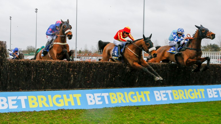 Pilgrims Bay (middle) makes his challenge in the BetBright Handicap Chase