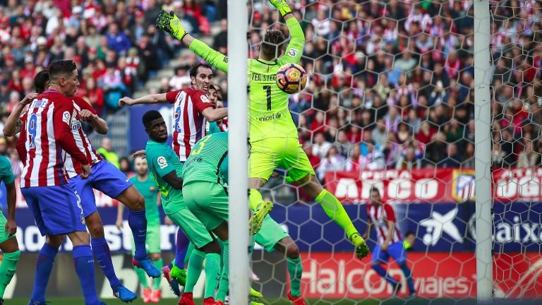 Diego Godin heads past Barcelona keeper Marc-Andre ter Stegen