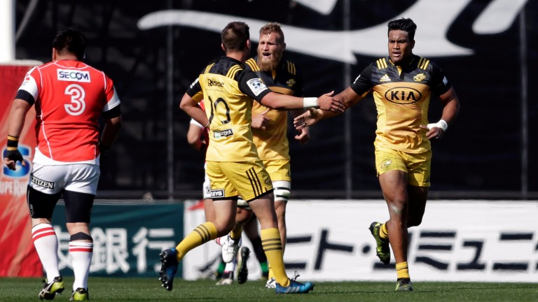 Hurricanes' Julian Savea (right) celebrates a try against the Sunwolves