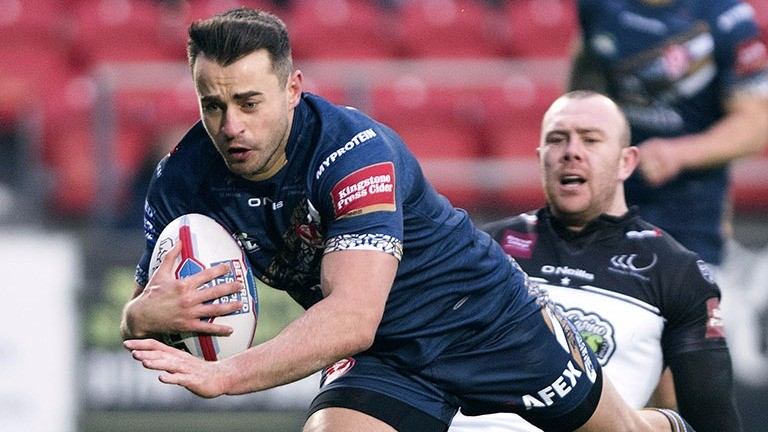 Ryan Morgan of St Helens scores the first try against Widnes