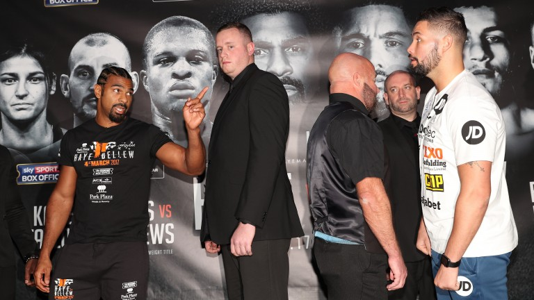 David Haye (left) and Tony Bellew are kept apart at the press conference