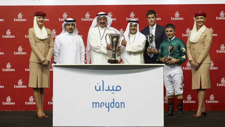 The Decorated Knight team receive the trophy for the Jebel Hatta at Meydan