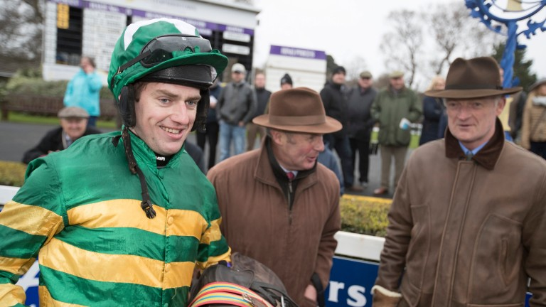 Willie Mullins (right) looks on as a delighted Jody McGarvey returns having landed an unlikely victory