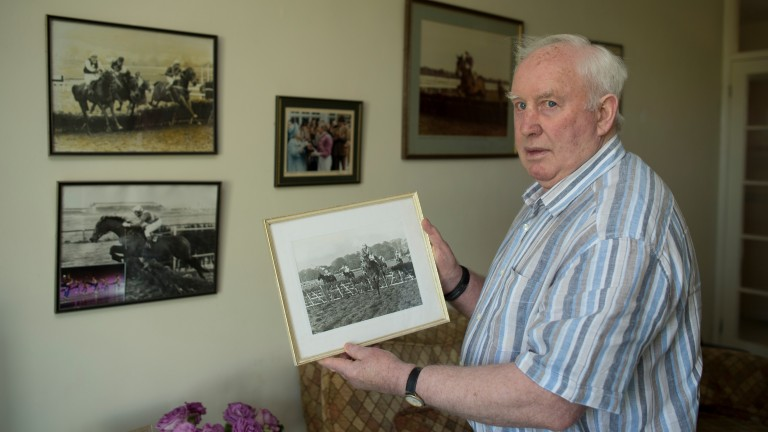 Paddy Broderick at home in Newmarket in 2013 holding a picture of Night Nurse winning the Leopardstown Hurdle