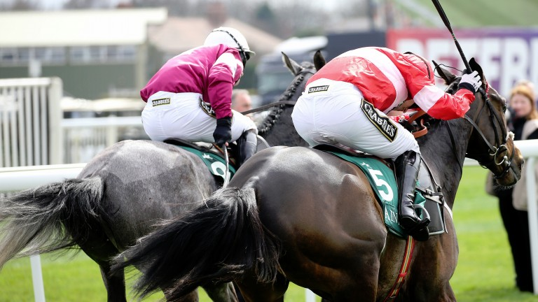 Buveur D'Air and Noel Fehily (near side) is just too good for Petit Mouchoir at Aintree