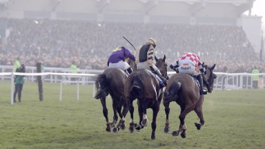 Lord Windermere and Davy Russell (left) win the Gold Cup from On His Own and The Giant Bolster following an inquiry into interference