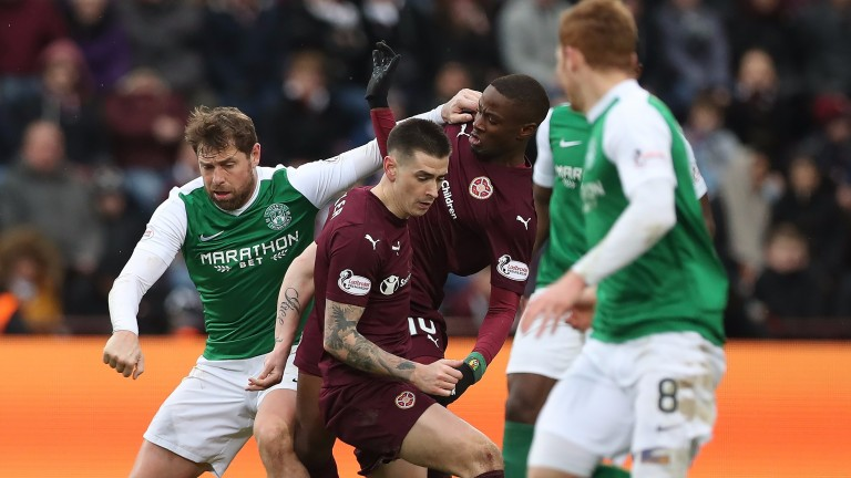 Hibs's Grant Holt (left) in the thick of the action against Hearts