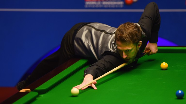 Judd Trump in action during his match against Ding Junhui during the World Championship