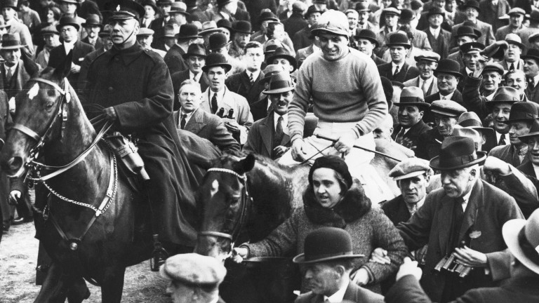 Dorothy Paget leads in Golden Miller after winning the 1934 Aintree Grand National