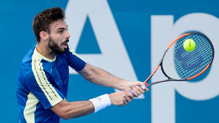 Marcel Granollers plays a backhand at the Sydney International