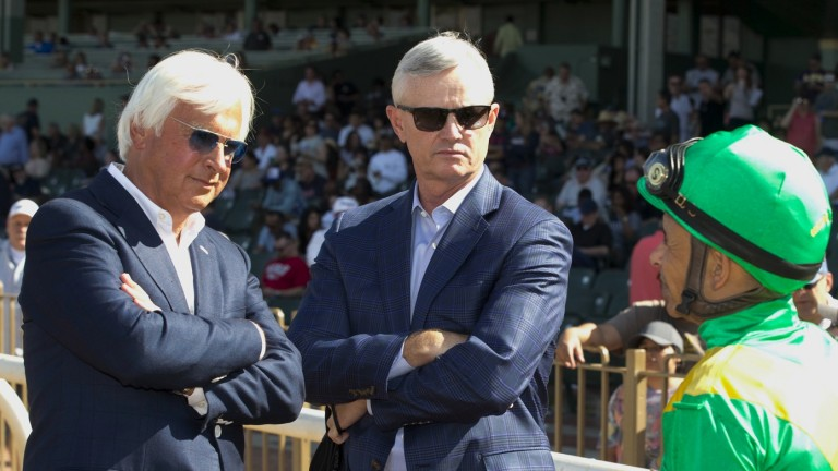 Jockey Mike Smith discusses Mastery's injury with trainer Bob Baffert (left) and owner Everett Dobson