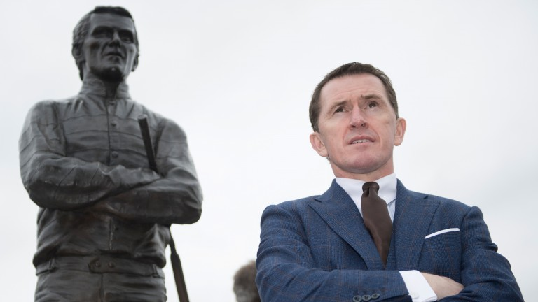 Sir AP McCoy and his statue Cheltenham 14.3.17 pic: Edward Whitaker