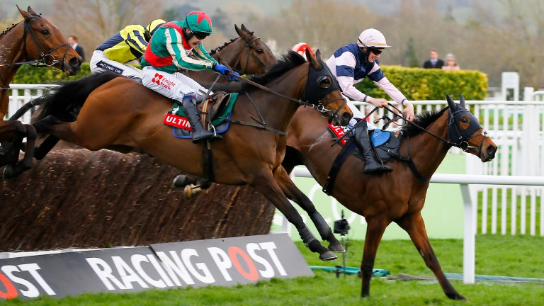 Un Temps Pour Tout  and Tom Scudamore (near side) follow Singlefarmpayment over the last on the way to success in the Ultima