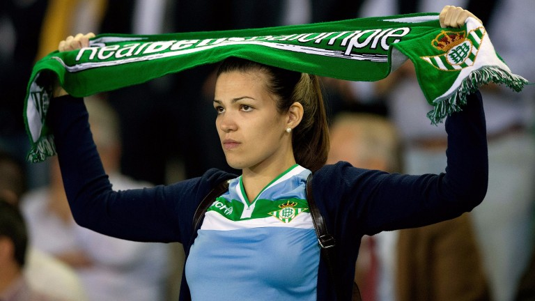 A Real Betis fan shows her colours