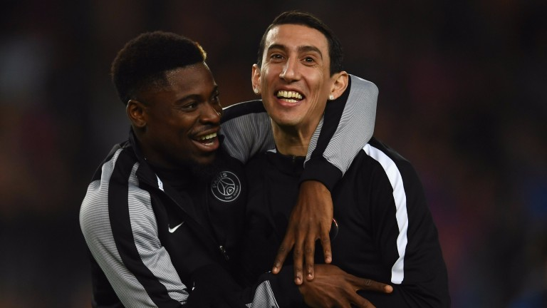 Serge Aurier (left) shares a joke with PSG pal Angel Di Maria