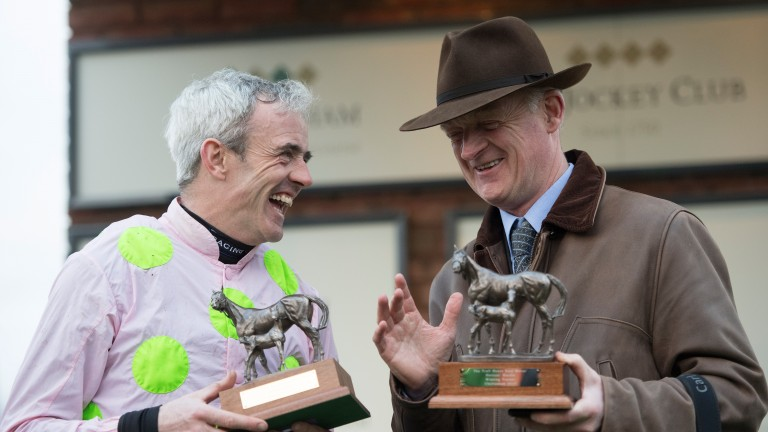Men of the moment: Ruby Walsh and Willie Mullins after Let's Dance brought up their four-timer in the mares' novices' hurdle