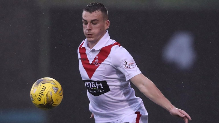 Adam Brown of Airdrie controls the ball