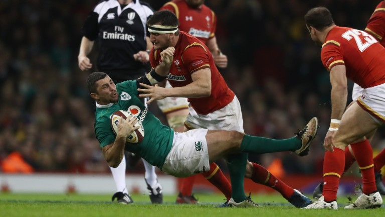 Wales flanker Sam Warburton leads the defensive charge against Ireland