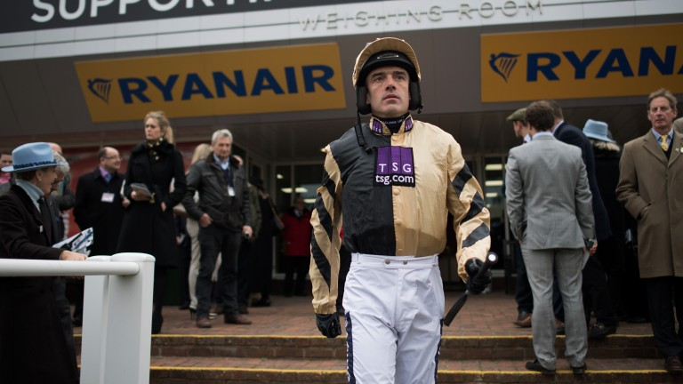 Ruby Walsh is focused on the job as he leaves the weighing room before the JLT Novices' Chase, which he won on Yorkhill
