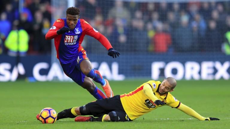 Watford's Adlene Guedioura tackles Palace winger Wilfried Zaha