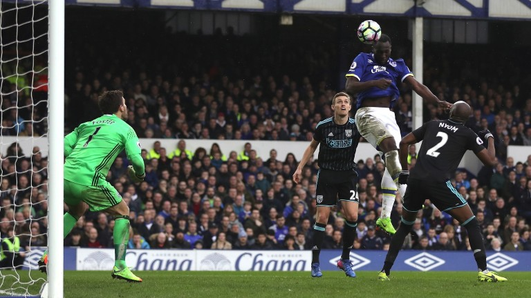 Romelu Lukaku heads home Everton's third goal against West Brom