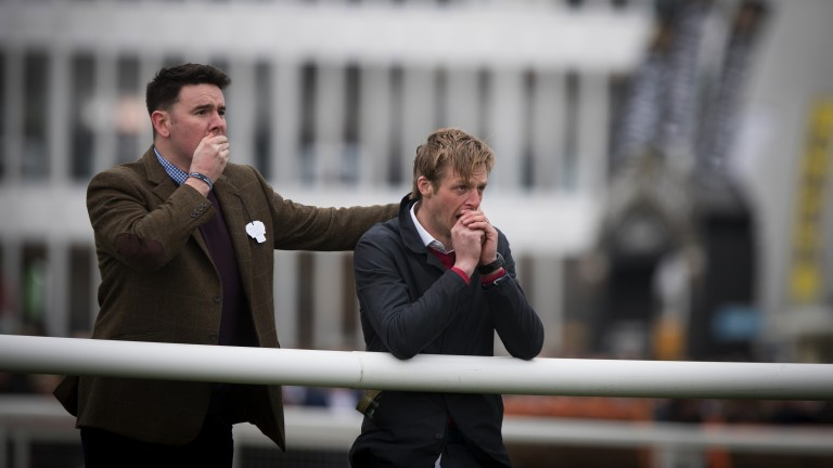Nail biter: two punters are in a nervous state as they watch the action unfold in the Foxhunter Chase
