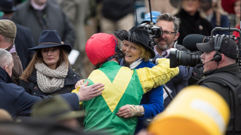 Jessica Harrington and Robbie Power embrace after Gold Cup victory with Sizing John