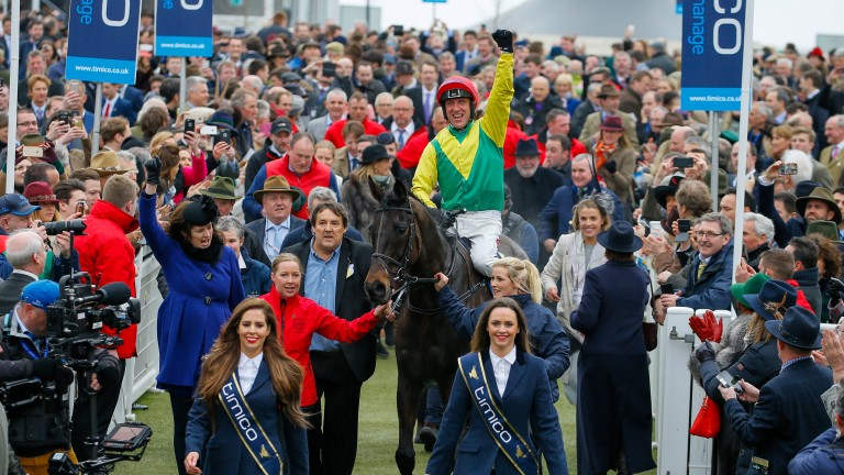Richard Melia (blue shirt) with Sizing John after Friday's Cheltenham Gold Cup
