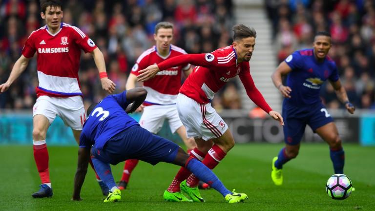 Eric Bailly of Man Utd (left) tackles Gaston Ramirez of Middlesbrough