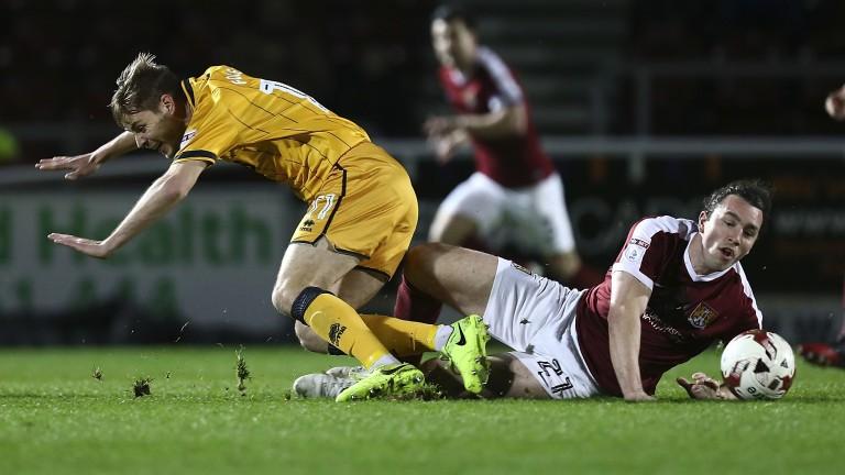 Port Vale's Sam Foley is tackled by Northampton's John-Joe O'Toole