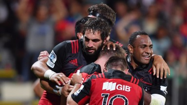 The Crusaders celebrate a try against the Blues