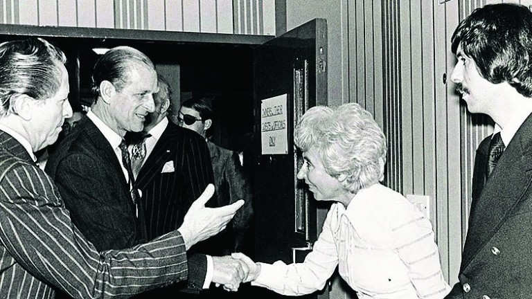 Roger Cearns (right) with parents John (left) and Doreen, welcome Prince Philip to Wimbledon in 1977