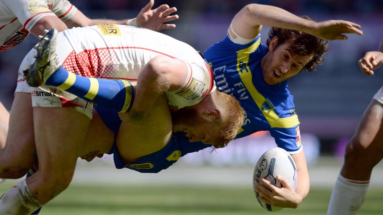 Warrington's Stefan Ratchford gets some unwelcome attention from Josh Jones of St Helens