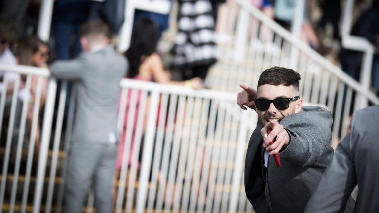 Great day out: a punter poses for the camera on student day at the track