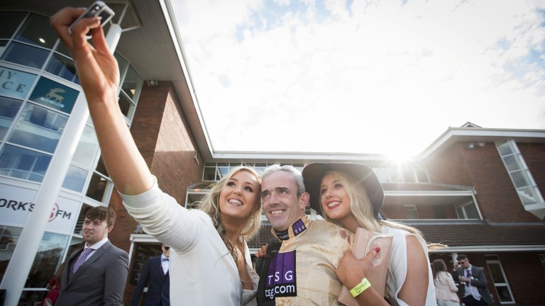 Selfie time: Ruby Walsh poses for the camera with two racegoers