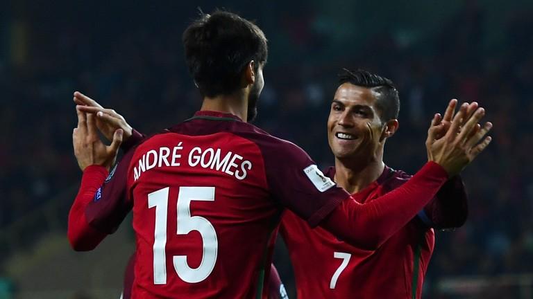 Portugal's Cristiano Ronaldo and Andre Gomes