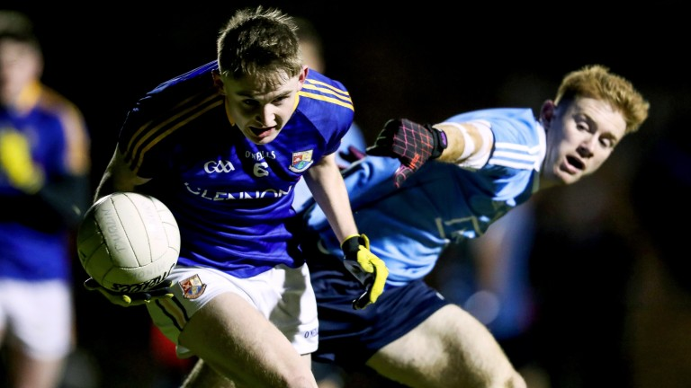 Aaron Byrne of Dublin (right) battles for the ball with Longford's Dessie Reynolds