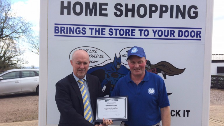 Tony Fowler (right) receives his award for services to the community
